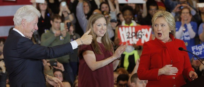 Former U.S. President Bill Clinton gives his wife Democratic U.S. presidential candidate Hillary Clinton a thumbs up as they celebrate with their daughter Chelsea at her caucus night rally in Des Moines