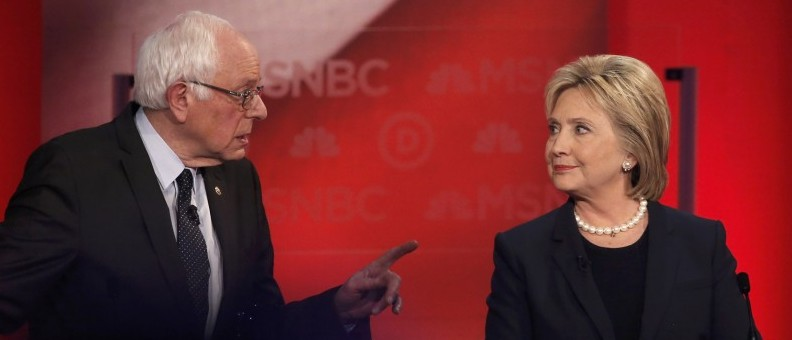 Democratic U.S. presidential candidate Senator Sanders speaks directly to former Secretary of State Clinton as they discuss issues during the Democratic presidential candidates debate sponsored by MSNBC at the University of New Hampshire in Durham