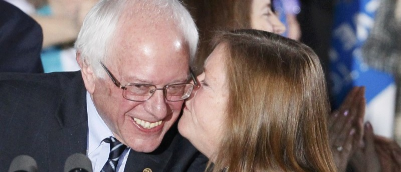 Democratic U.S. presidential candidate Bernie Sanders gets a kiss from his wife after winning at his 2016 New Hampshire presidential primary night rally in Concord