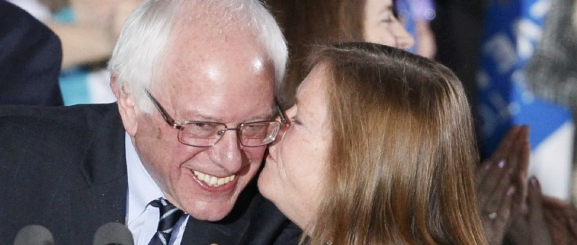 Democratic U.S. presidential candidate Bernie Sanders gets a kiss from his wife Jane after winning at his 2016 New Hampshire presidential primary night rally in Concord, New Hampshire February 9, 2016. REUTERS/Rick Wilking