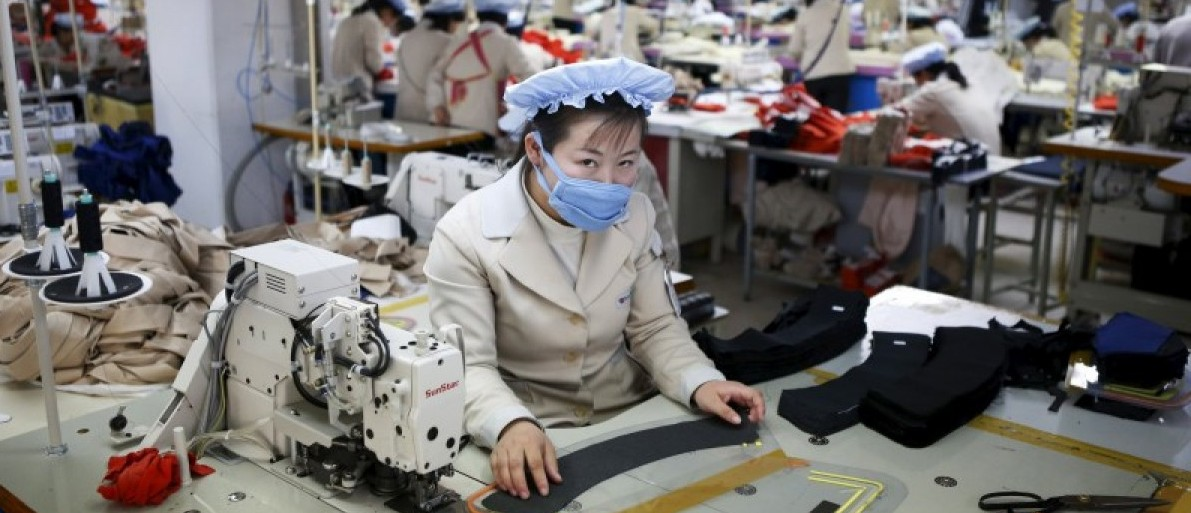A North Korean employee works in a factory of a South Korean company at the Joint Industrial Park in Kaesong industrial zone, a few miles inside North Korea from the heavily fortified border in this December 19, 2013 file photo. REUTERS/Kim Hong-Ji/Files