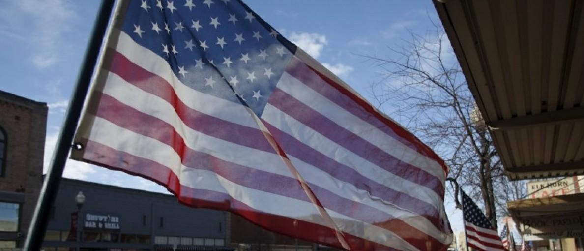 American flags line Broadway Ave. in Burns, Oregon February 11, 2016. REUTERS/Jim Urquhart