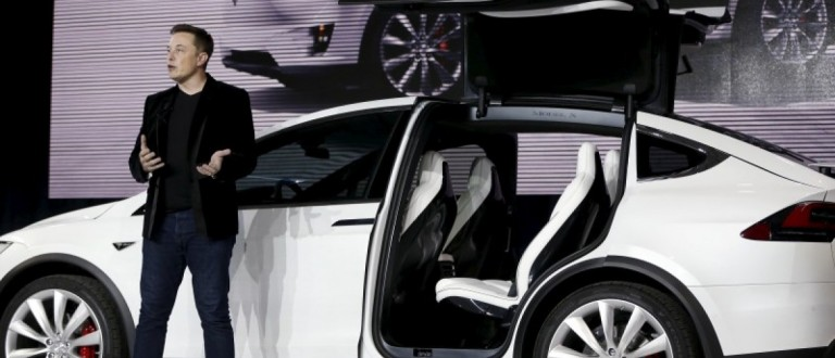 Tesla Motors CEO Elon Musk introduces the falcon wing door on the Model X electric sports-utility vehicles during a presentation in Fremont, California in this September 29, 2015, file photo. REUTERS/Stephen Lam/Files