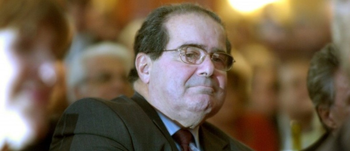 U.S. Supreme Court Justice Antonin Scalia sits in the audience at a National Italian American Foundation event in Washington, in this file photo taken October 20, 2006.   REUTERS/Jonathan Ernst/Files