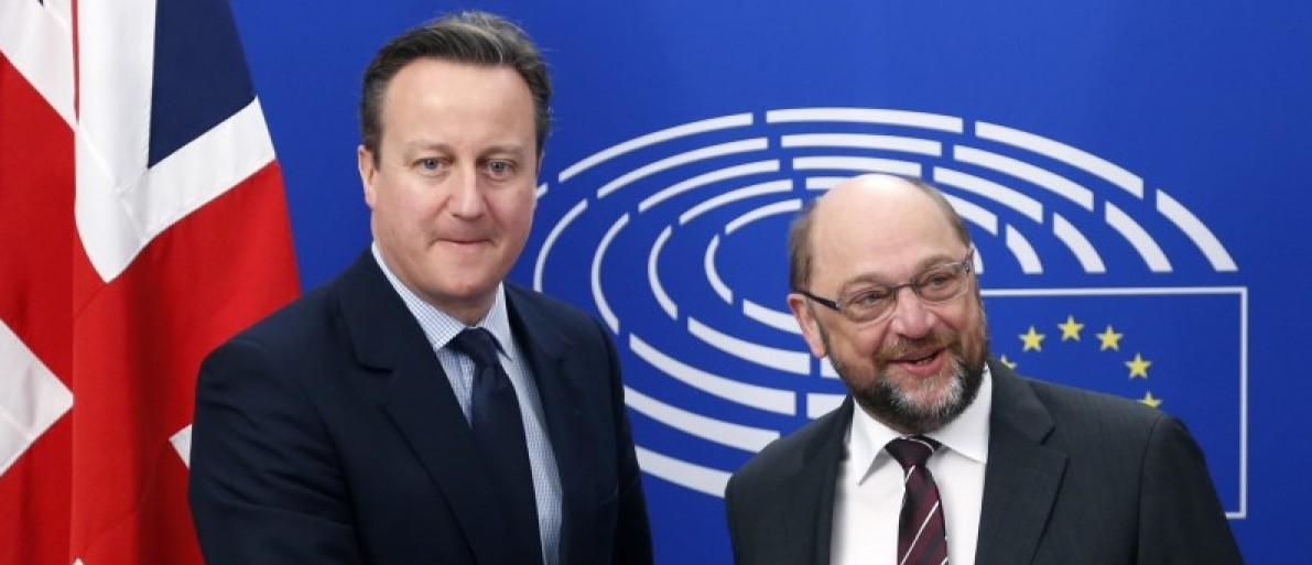 Britain's PM Cameron poses with EU Parliament President Schulz in Brussels