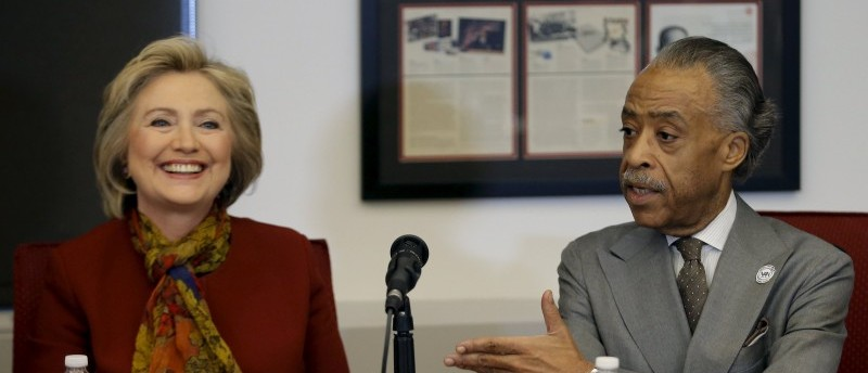 Democratic presidential candidate Hillary Clinton sits with The Reverend Al Sharpton, Founder and President of the National Action Network, as she meets with civil rights leaders at the National Urban League in the Manhattan borough of New York City