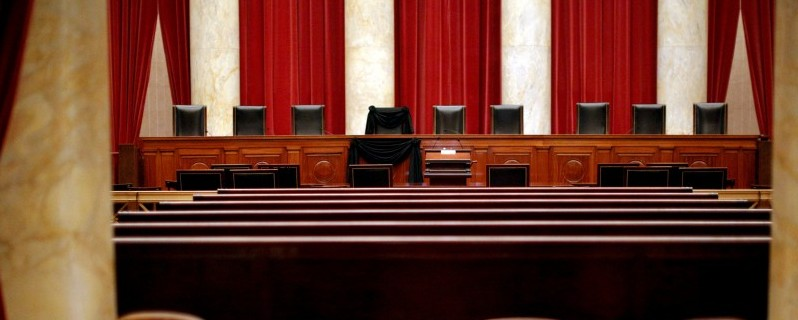The bench of late Supreme Court Justice Antonin Scalia is seen draped with black wool crepe in memoriam inside the Supreme Court in Washington