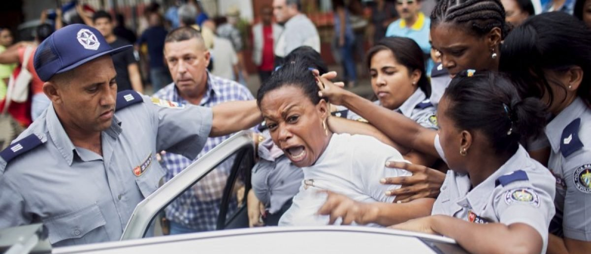 "Cuban security personnel detain a member of the Ladies in White dissident group during a protest on International Human Rights Day, Havana, December 10, 2015. Cuban police detained at least six protesters shouting ""Freedom"" and ""Long live human rights"" in Havana on Thursday and dissidents reported 100 arrests nationwide on U.N. Human Rights Day, when some Cubans seek to hold unauthorized demonstrations. REUTERS/Alexandre Meneghini"