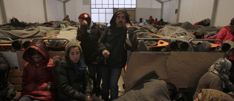 Syrian refugees wait inside a tent at a camp as they wait to be allowed to cross the Greek-Macedonian border, near the village of Idomeni, Greece, February 22, 2016. REUTERS/Alexandros Avramidis