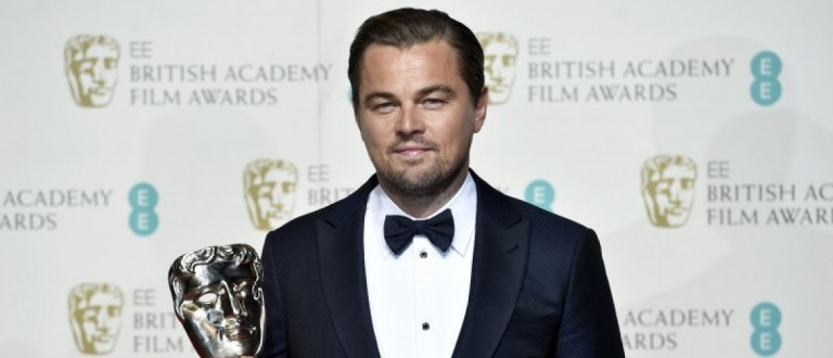 Leonardo DiCaprio holds his award for best leading actor at the British Academy of Film and Television Arts (BAFTA) Awards at the Royal Opera House in London, February 14, 2016. REUTERS/Toby Melville