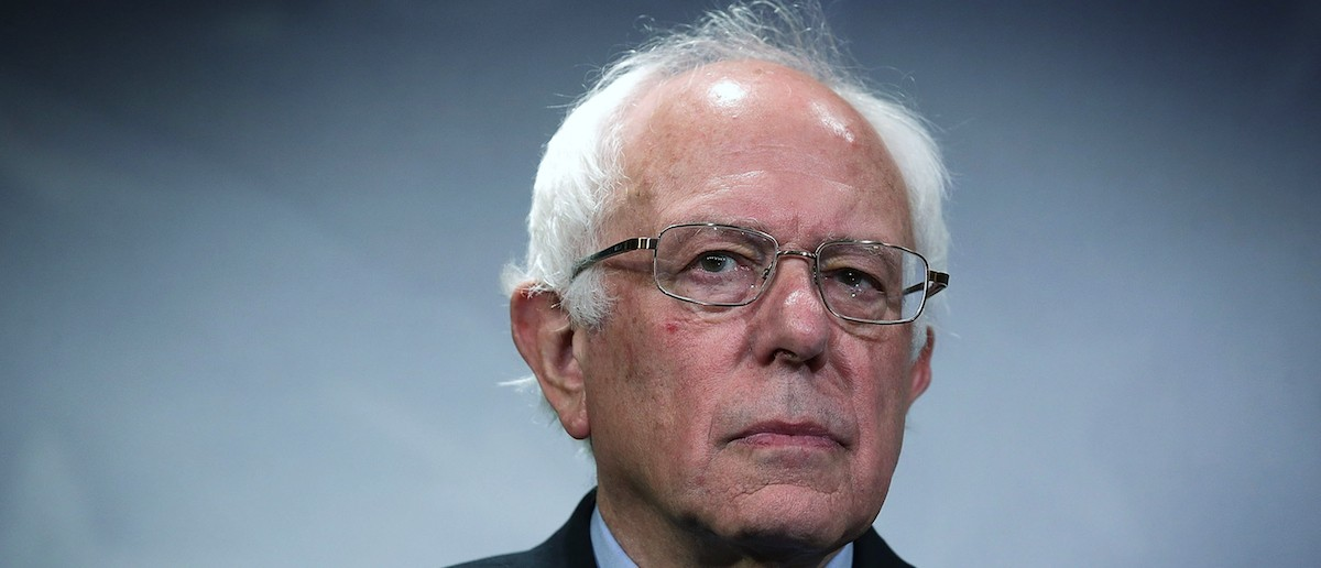 U.S. Sen. Bernie Sanders (I-VT) listens during a news conference about private prisons September 17, 2015 on Capitol Hill in Washington, DC. Sanders was joined by Rep. Keith Ellison (D-MN) to announce that they will introduce bills to ban private prisons. (Photo by Alex Wong/Getty Images)