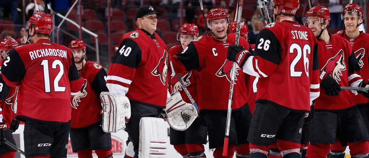 Backup goaltender Nathan Schoenfeld #40 of the Arizona Coyotes celebrates on the ice with Shane Doan #19 and Michael Stone #26 following the NHL game against the Montreal Canadiens at Gila River Arena on Feb. 15, 2016 in Glendale, Arizona. The Coyotes defeated the Canadiens 6-2. (Photo by Christian Petersen/Getty Images)