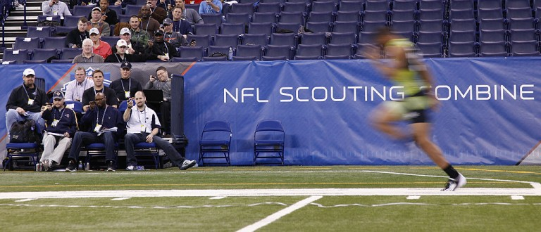 INDIANAPOLIS, IN - FEBRUARY 28: Scouts look on as a player runs the 40-yard dash during the 2012 NFL Combine at Lucas Oil Stadium on February 28, 2012 in Indianapolis, Indiana. (Photo by Joe Robbins/Getty Images)