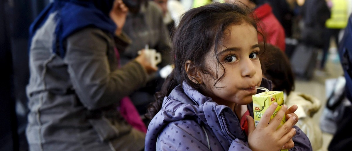 Young Iraqi refugee Wed drinks as she waits for getting into a refugee reception centre in Tornio, northwestern Finland, on September 18, 2015. (JUSSI NUKARI/AFP/Getty Images)