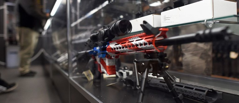 A rifle with a gunskin in the colors of the US flag is seen at the RTSP shooting range in Randolph, New Jersey on December 9, 2015. US President Barack Obama called for tougher gun controls in the wake of the California shootings, starting with a ban on gun purchases for anyone on a US government no-fly list. AFP PHOTO/JEWEL SAMAD / AFP / JEWEL SAMAD        (Photo credit should read JEWEL SAMAD/AFP/Getty Images)