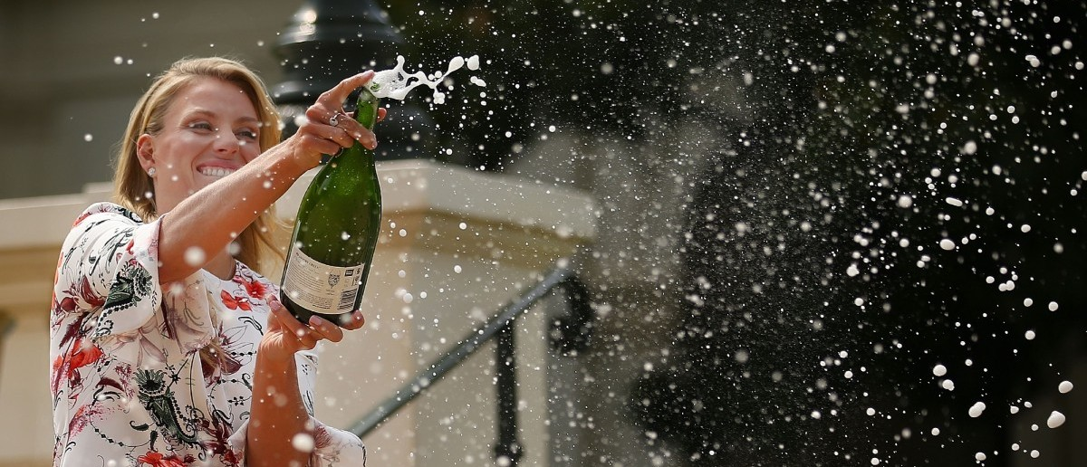 Angelique Kerber spraying wine  (Photo by Scott Barbour/Getty Images)