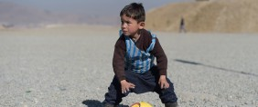 Afghan boy five-year-old Murtaza Ahmadi, a young Lionel Messi fan, plays football in Kabul on February 1, 2016. Barcelona star Lionel Messi is hoping to arrange a meeting with an Afghan boy who shot to fame after pictures of him dressed in a striped plastic bag jersey went viral, Kabul's football federation said on February 1.  (SHAH MARAI/AFP/Getty Images)