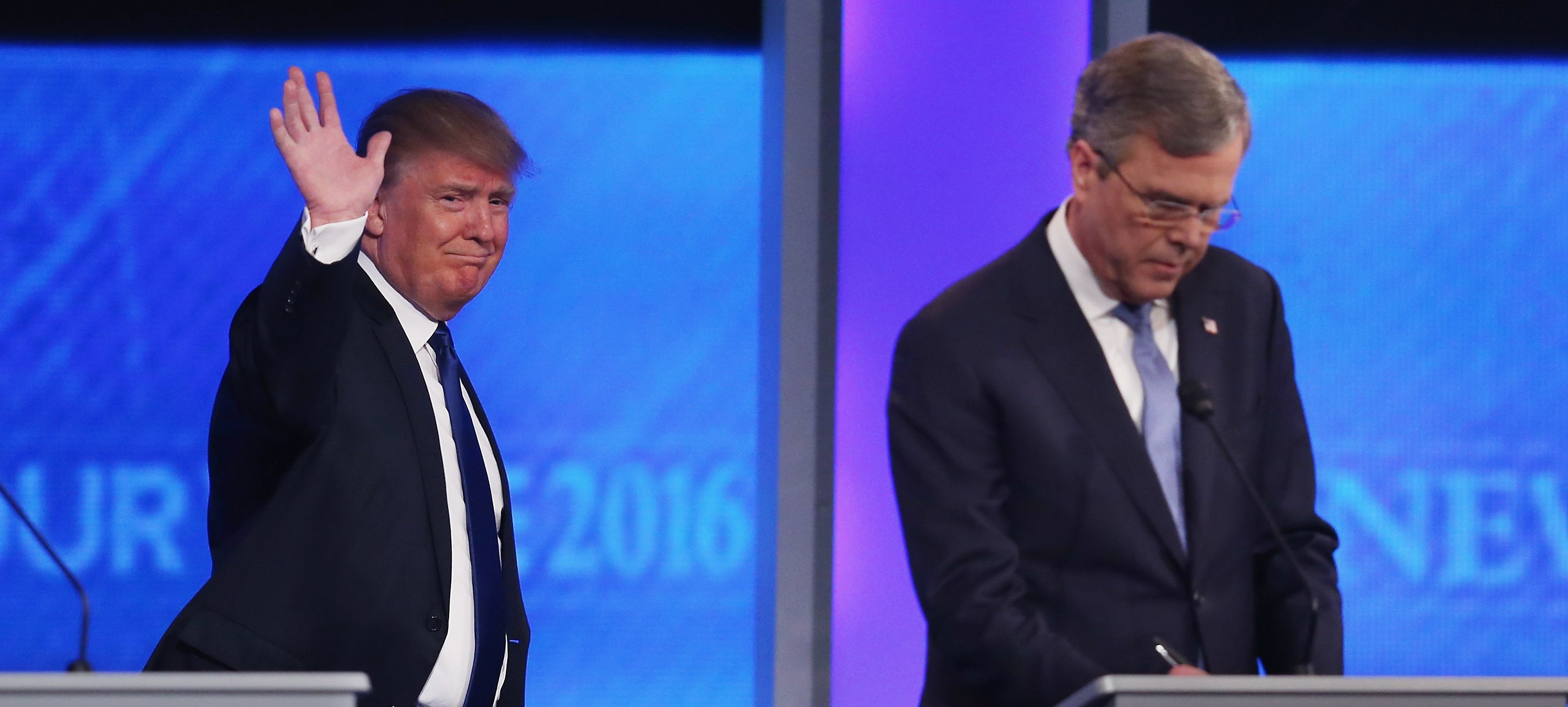 MANCHESTER, NH - FEBRUARY 06:  Republican presidential candidates Donald Trump (L) and  Jeb Bush take the stage for the Republican presidential debate at St. Anselm College February 6, 2016 in Manchester, New Hampshire. Sponsored by ABC News, the Independent Journal Review and Google, this is the final televised debate before voters go to the polls for the New Hampshire primary on February 9.  (Photo by Joe Raedle/Getty Images)
