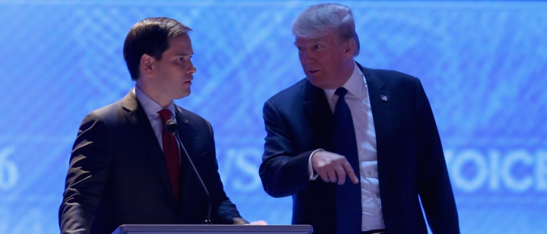 MANCHESTER, NH - FEBRUARY 06:  Republican presidential candidates Sen. Marco Rubio (R-FL) (L) and Donald Trump visit during commercial break in the Republican presidential debate at St. Anselm College February 6, 2016 in Manchester, New Hampshire. Sponsored by ABC News and the Independent Journal Review, this is the final televised debate before voters go to the polls for the New Hampshire primary on February 9.  (Photo by Joe Raedle/Getty Images)