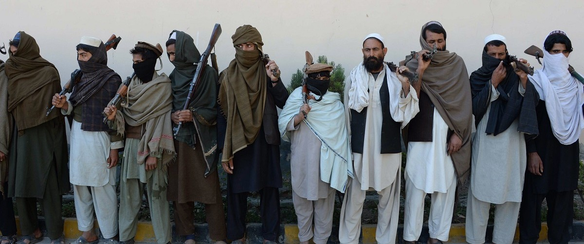 Afghan alleged former Taliban fighters carry their weapons before handing them over as part of a government peace and reconciliation process at a ceremony in Jalalabad on February 24, 2016. More than a dozen former Taliban fighters from Nazyan district of Nangarhar province handed over their weapons as part of a peace reconciliation program. (NOORULLAH SHIRZADA/AFP/Getty Images)