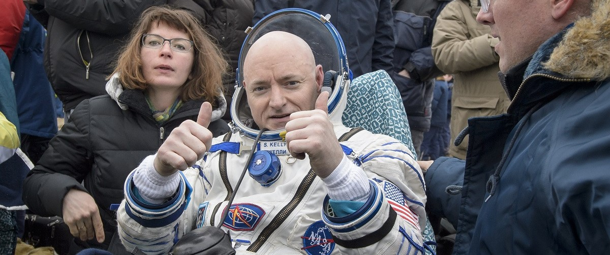 In this handout provided by NASA, Expedition 46 Commander Scott Kelly of NASA rest in a chair outside of the Soyuz TMA-18M spacecraft just minutes after he and Russian cosmonauts Mikhail Kornienko and Sergey Volkov of Roscosmos landed in a remote area on March 2, 2016 near the town of Zhezkazgan, Kazakhstan. Kelly and Kornienko completed an International Space Station record year-long mission to collect valuable data on the effect of long duration weightlessness on the human body that will be used to formulate a human mission to Mars. Volkov returned after spending six months on the station. Bill Ingalls/NASA via Getty Images.