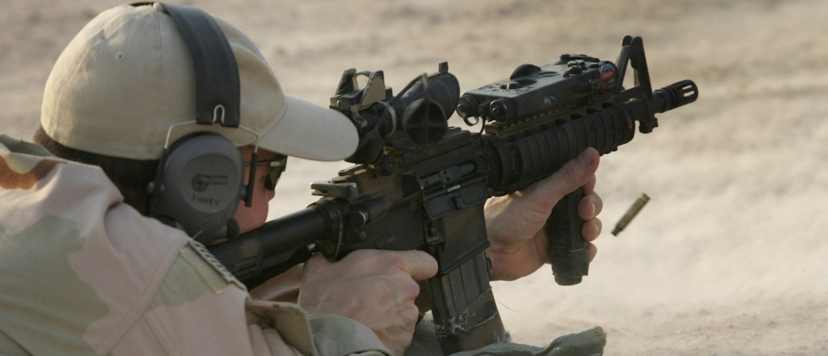 A U.S. Navy SEAL fires his M-4 assault rifle during a training session with Iraqi army scouts July 26, 2007 in Fallujah, Iraq. The SEALS are training Iraqi forces on advanced combat techniques as part of the American effort to build up the Iraqi military. (Photo by John Moore/Getty Images)