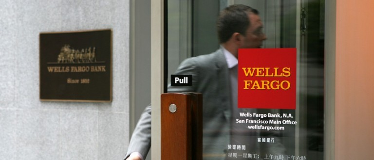A Wells Fargo customer enters a bank branch  (Photo by Justin Sullivan/Getty Images)