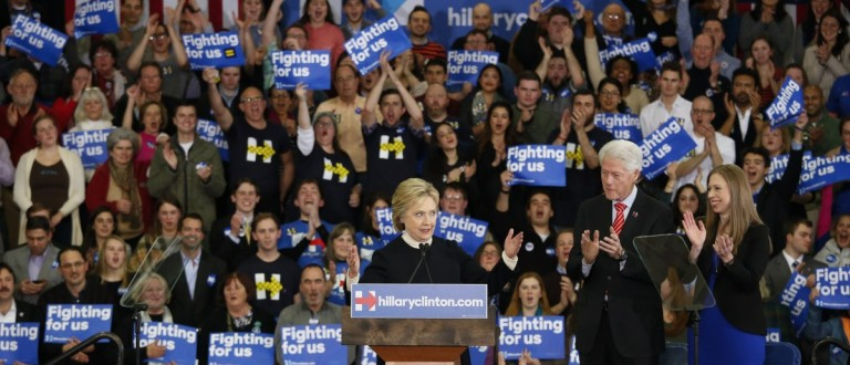 Democratic presidential candidate Hillary Clinton is accompanied by her daughter Chelsea and her husband President Clinton as she speaks to supporters at her final 2016 New Hampshire presidential primary night rally in Manchester