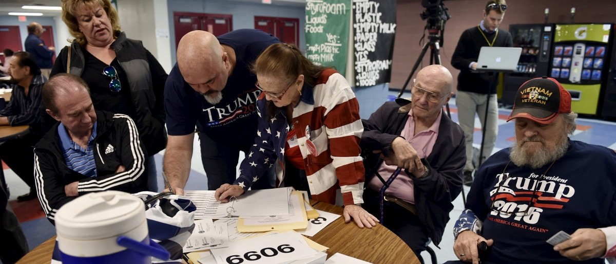 Voters sign in to cast their ballots during the Nevada Republican presidential caucus at Western High School in Las Vegas
