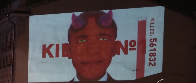Obama Portrayed As Mass-Murdering Devil In Russian Video [screen shot YouTube]
