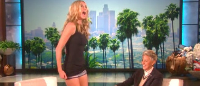Heidi Klum wears short dress on live TV.