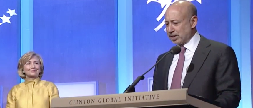 Hillary Clinton looks on as Goldman Sachs CEO speaks at the Clinton Global Initiative (Screen shot/YoutTube)