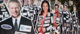 Cardboard cutouts of state assembly members and senators covered in stickers of their top donors. (Photo: California Is Not For Sale/youtube)