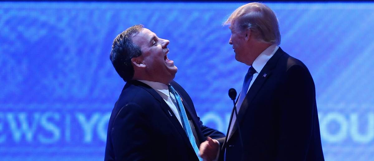 Trump and Christie during a break in the New Hampshire debate. Carlo Allegri/Reuters.