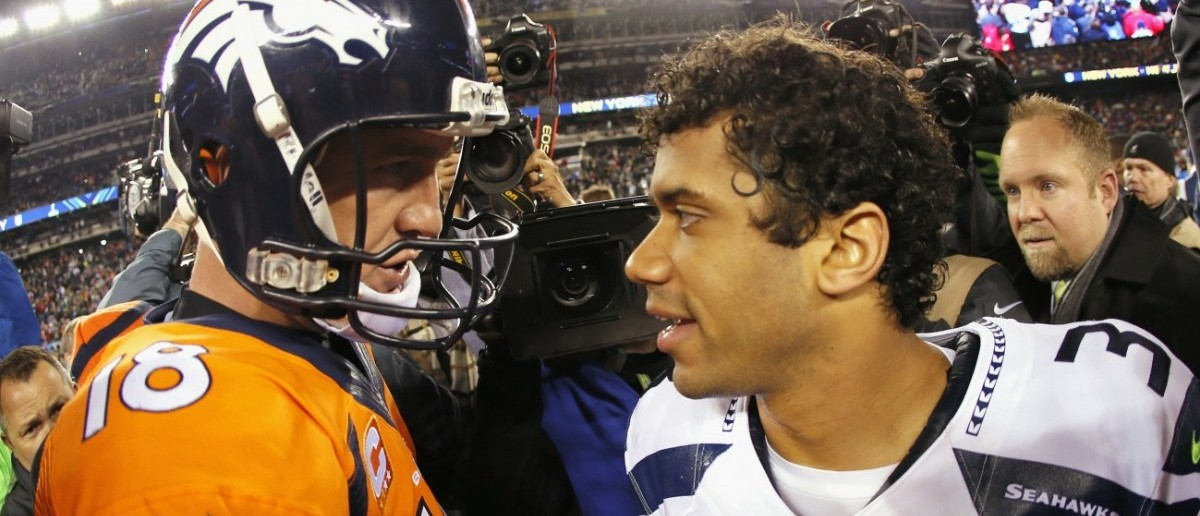 Russell Wilson and Peyton Manning (Credit: Getty Images/Kevin C. Cox)