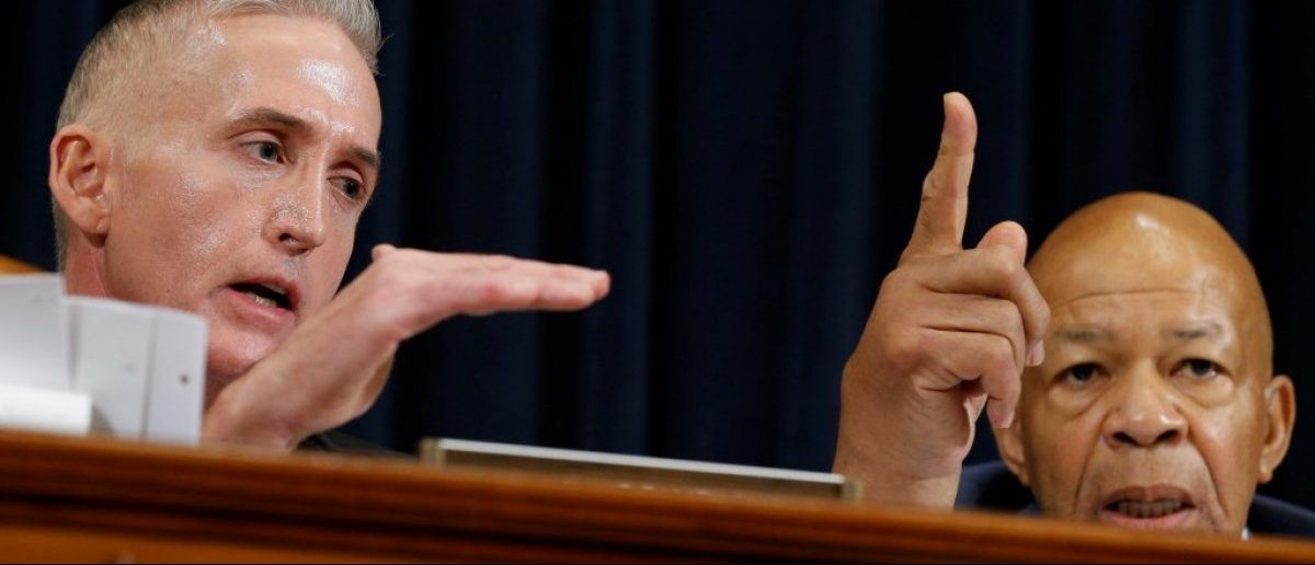 House Benghazi committee Chairman Trey Gowdy (R-S.C.) (L) and ranking member Elijah Cummings (D-Md.) debate the release of emails and transcripts of witness testimony on Capitol Hill in Washington October 22, 2015. REUTERS/Jonathan Ernst
