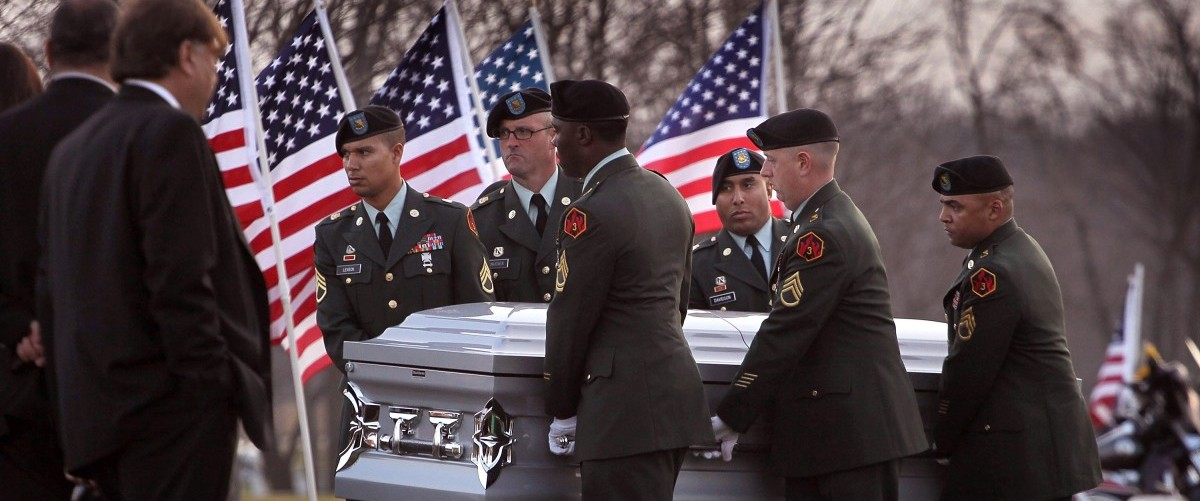 Soldiers carry the remains of U.S. Army PFC Andrew Meari, of Plainfield, Illinois to their final resting place at Abraham Lincoln National Cemetery on November 11, 2010 in Elwood, Illinois. Meari, who was assigned to 1st Battalion, 502nd Infantry Regiment, 2nd BCT, of the 101st Airborne Division out of Fort Campbell, Kentucky, was killed November 1, in Kandahar, Afghanistan alongside fellow soldier SPC Jonathan Curtis when an insurgent attacked their unit with an improvised explosive device (IED).  (Photo by Scott Olson/Getty Images)
