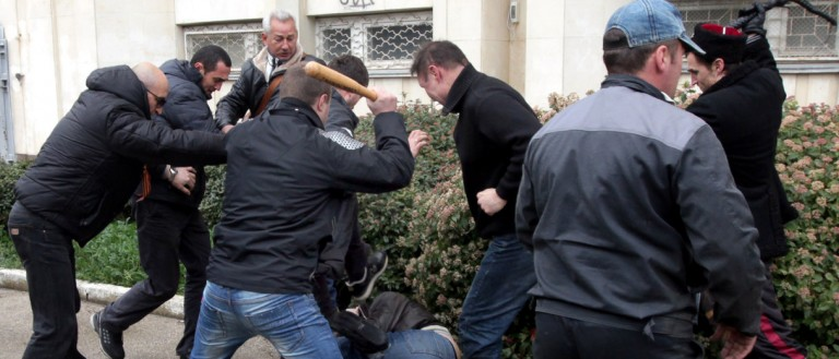 """Pro-Russian """"self-defence"""" activists use a bat and a whip to beat a pro-Ukrainian supporter during clashes in Sevastopol on March 9, 2014. Pro-Kiev and pro-Moscow groups clashed in the Crimean city of Sevastopol on March 9 following a rally in support of Ukraine's new government, an AFP reporter witnessed. Pro-Russian activists attacked a pro-Kiev rally in Sevastopol with clubs and whips on March 9 as thousands took to the streets across Ukraine in rival demonstrations, escalating separatist tensions in the troubled ex-Soviet state. Interim Prime Minister Arseniy Yatsenyuk vowed Ukraine would not cede """"an inch"""" of its territory to Moscow after Russian forces and pro-Kremlin gunmen took over the Black Sea peninsula. AFP PHOTO/ STRINGER (Photo credit should read STRINGER/AFP/Getty Images)"""