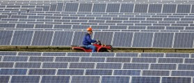 An employee rides a quad bike during an inspection of a solar power station on the outskirts of Simferopol, March 25, 2014. Russia and the West sought to draw a provisional line under the Ukraine crisis on Tuesday after major industrialised nations warned Moscow of tougher economic sanctions if it goes beyond the seizure of Crimea. REUTERS/Vasily Fedosenko (UKRAINE - Tags: POLITICS ENERGY)