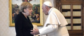 German Chancellor Angela Merkel talks with Pope Francis during a private audience at the Vatican February 21, 2015. REUTERS/Maurizio Brambatti/Pool