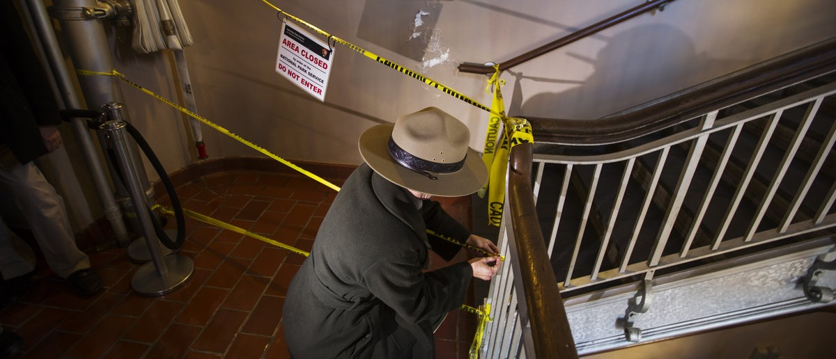 National Park Service Ranger Mindi Rambo opens a closed area for reporters to access a stairwell of the Ellis Island immigration museum building in New York October 28, 2013. Ellis Island, the patch of land on New York Harbor where millions of immigrants first touched U.S. soil, partially reopened to the public on Monday, almost a year after it was submerged by Superstorm Sandy's floodwaters. REUTERS/Lucas Jackson