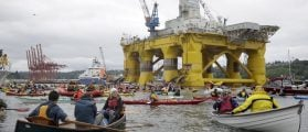 Activists protest the Shell Oil Company's drilling rig Polar Pioneer which is parked at Terminal 5 at the Port of Seattle, Washington May 16, 2015. Hundreds of activists in kayaks and small boats fanned out on a Seattle bay on Saturday to protest plans by Royal Dutch Shell to resume oil exploration in the Arctic and keep two of its drilling rigs stored in the city's port. REUTERS/Jason Redmond