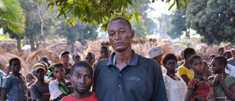 Jean-Pierre Kitenge Amisi, a Bantu, poses for a photograph with Budjita Kyungu Ndaye, a Pygmy, in Nyemba village, in southeastern Democratic Republic of the Congo, November 24, 2015. Jean-Pierre Kitenge Amisi is the leader of internally displaced people. Bantus and Pygmies study in the same schools and go to the market together. Budjita Kyungu Ndaye says he is afraid of Pygmy militiamen attacking. Picture taken November 24, 2015. REUTERS/Habibou Bangre