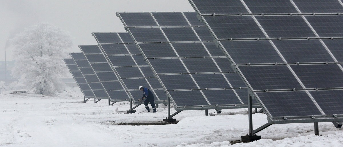 Dmitry Baikalov, a duty engineer, inspects equipment at the Abakan solar electric station in a suburb of the Siberian town of Abakan, Khakassia Republic, Russia, December 17, 2015. Owned by EuroSibenergo company of the En+ Group, the solar electric plant in Siberia with a generating capacity of 5.2 megawatt (MW) will be in operation on December 21, according to the official representative of the company. Picture taken December 17, 2015. REUTERS/Ilya Naymushin