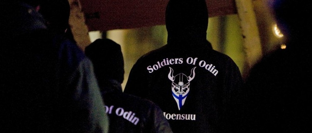 "A group that call themselves the ""Soldiers of Odin"" demonstrate in Joensuu, Eastern Finland, January 8, 2016. Wearing black jackets adorned with a symbol of a Viking and the Finnish flag, the ""Soldiers of Odin"" have surfaced as self-proclaimed patriots patrolling the streets to protect native Finns from immigrants, worrying the government and police.  REUTERS/Minna Raitavuo/Lehtikuva"