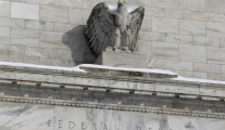 Snow rests on the eagle statue atop the U.S. Federal Reserve in Washington January 26, 2016. The Federal Reserve is expected to leave interest rates unchanged on Wednesday and acknowledge that turmoil in financial markets threatens its upbeat view of the U.S. economy, leaving the chances of a March hike diminished but alive. REUTERS/Jonathan Ernst