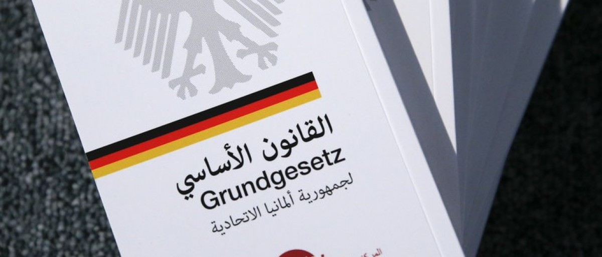 Copies of the German constitution translated into Arabic are pictured at  the German Federal Agency for Civic Education in Berlin, Germany, February 3, 2016.    REUTERS/Fabrizio Bensch