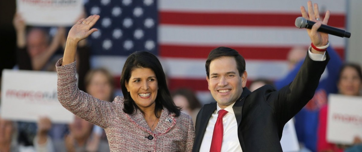 South Carolina Governor Nikki Haley (L) and U.S. Republican presidential candidate Marco Rubio react on stage during a campaign event in Chapin, South Carolina February 17, 2016. Haley announced her endorsement of Rubio for the Republican presidential nomination. (REUTERS/Chris Keane)