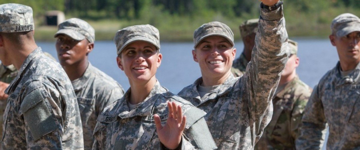 Capt. Kristen Griest (L) and 1st Lt. Shaye Haver wave to friends and family gathered during the graduation ceremony of the United States Army's Ranger School on August 21, 2015 at Fort Benning, Georgia . Griest and Haver are the first women ever to successfully complete the U.S. Army's Ranger School. (Photo by Jessica McGowan/Getty Images)