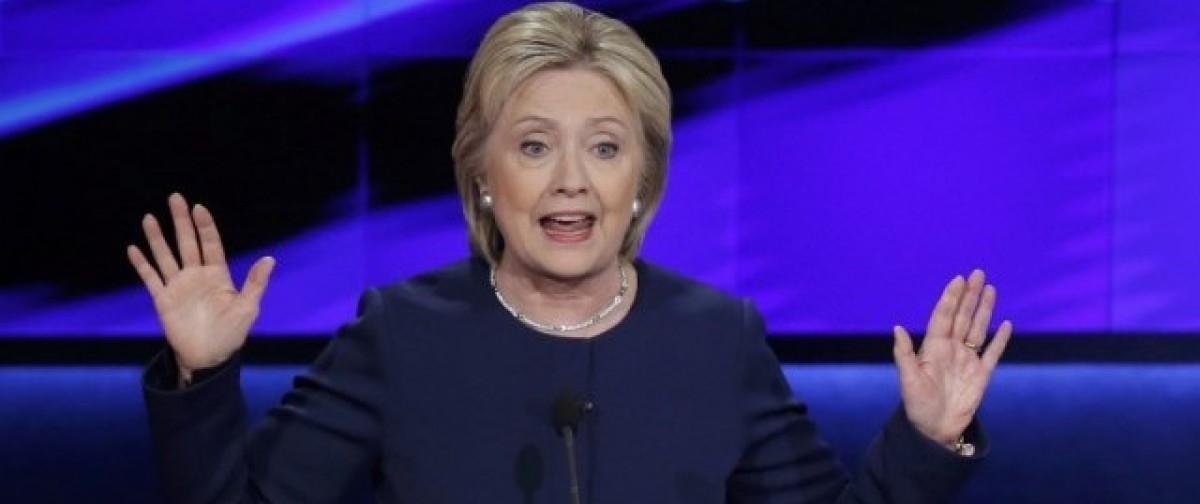 Democratic U.S. presidential candidate Hillary Clinton speaks during the Democratic U.S. presidential candidates' debate in Flint, Michigan, March 6, 2016. REUTERS/Jim Young